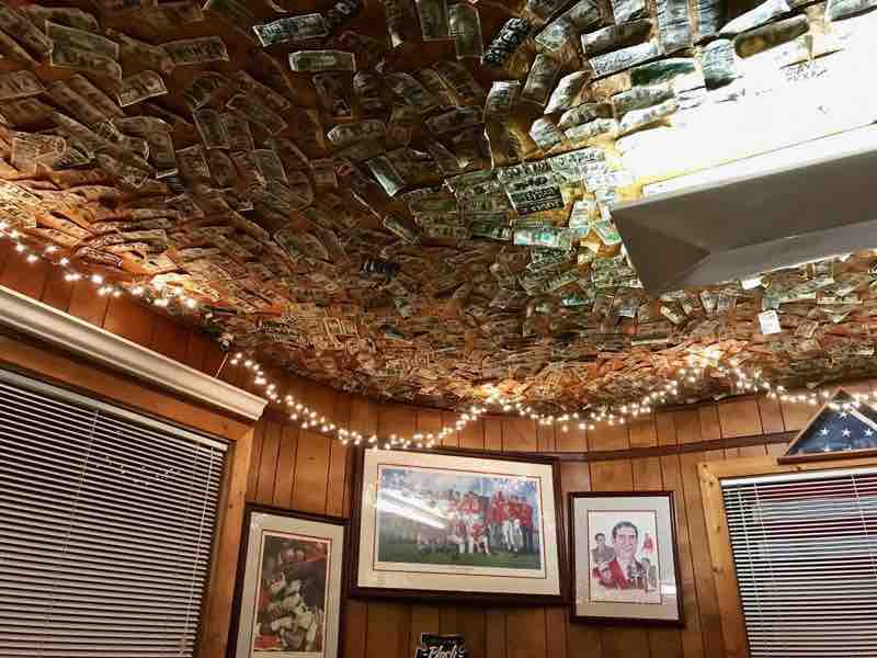 Dollar bills stuck to the wall at Nick's in the Sticks | nevertooldtotravel.com | Gary House