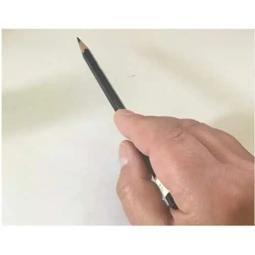 holding a pencil