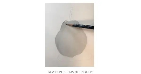 add more graphite to the dark areas of the pear
