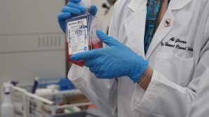 Abi Glen cross showing a vial in the lab
