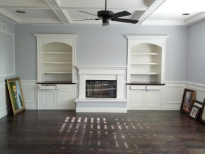 Interior painted walls, cabinets, and coffered ceiling