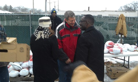Congressman Bill Huizenga and the Honorable Gregory C. Pittman at the 2013 turkey giveaway.
