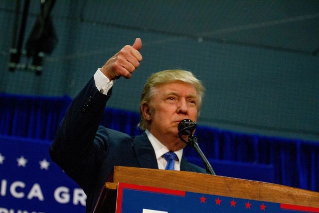 Donald Trump giving a thumbs-up at a rally in Newtown, PA