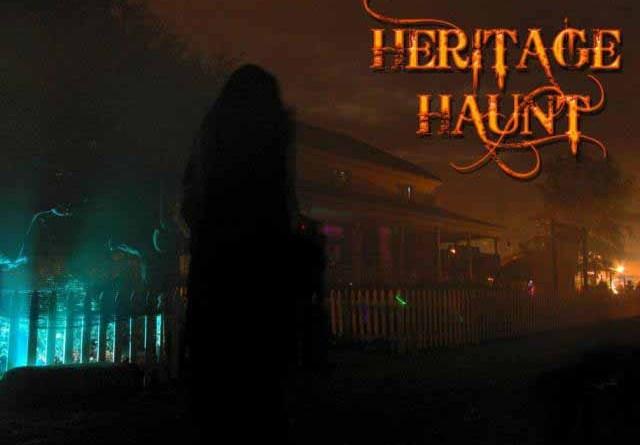 A lurking phantom stands in front of Heritage Haunt