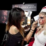 A makeup artist preps a nurse from SILENT HILL for Halloween Horror Nights 2012