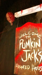 Pumpkin Jack's Haunted House sign with monster