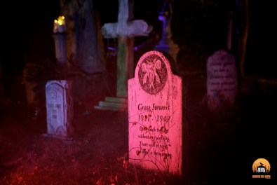 Tombstones await your perusal within the Mourning Rose Cemetery.