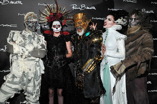 Rick Baker (center) surrounded by models showcasing his M-A-C Collection. (Photo by John Sciulli/Getty Images for MAC Cosmetics)
