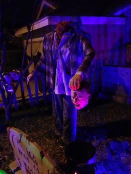 coffinwood-cemetery-body-with-head-in-hand