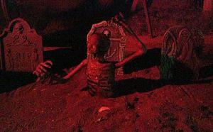 never-rest-cemetery-skeleton-in-ground