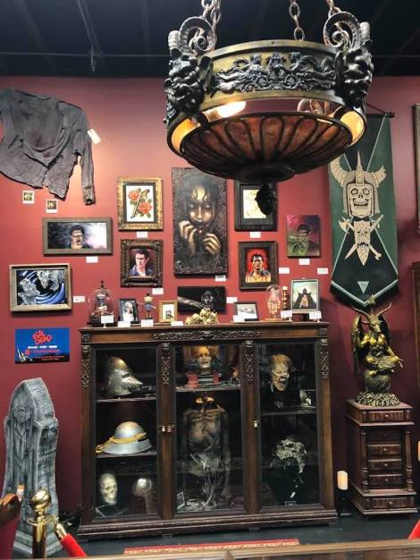 Amazing display of Evil Dead art and props