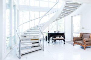 an entry way with a majestic spiral staircase