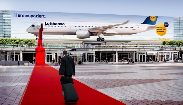 Welcome billboard at Munich airport's west facade by Lufthansa.