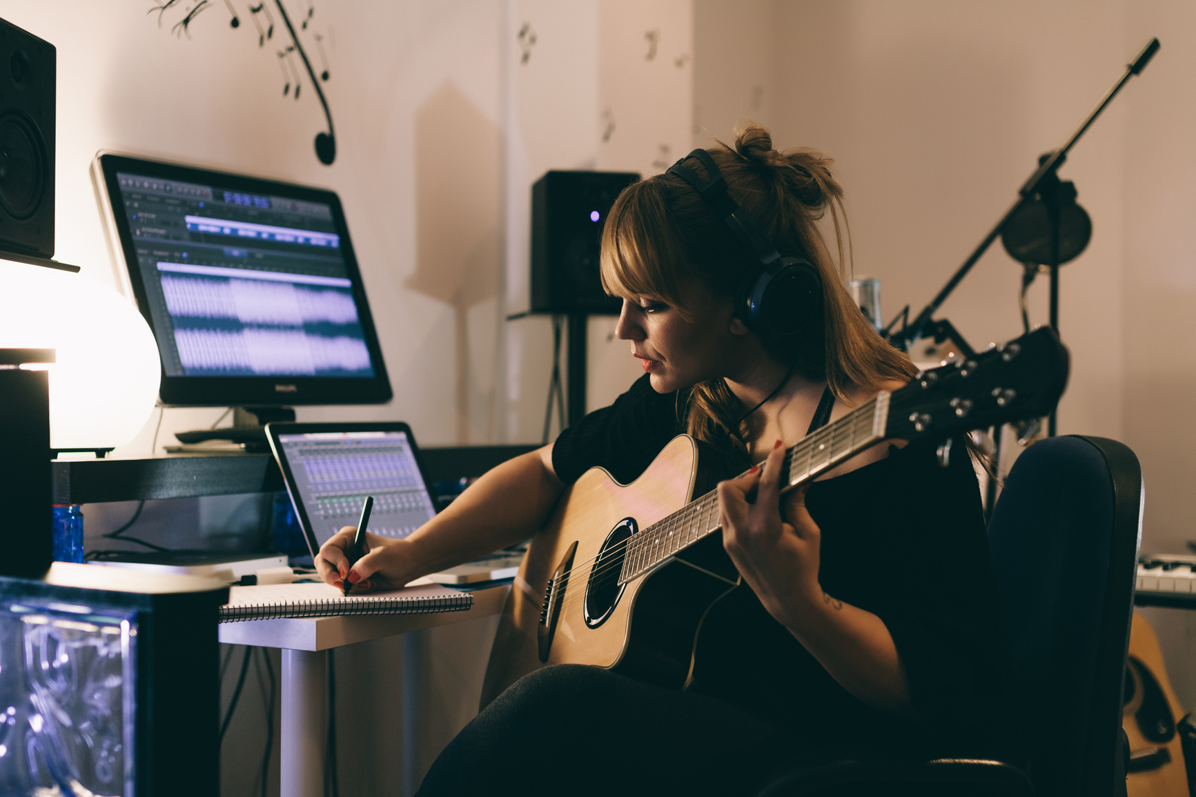 Woman working on her music career in Her Home Sound Studio