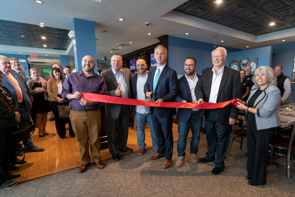 Business people cutting red tape
