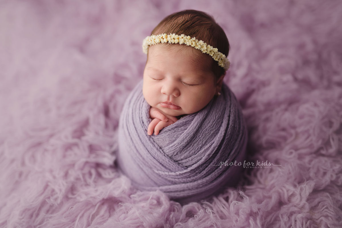 little new born girl on a pink blanke in a photography workshop by Nicoleta Raftu