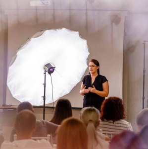 Olga Vuscan New Born Photographer for Workshops by Camen Bergmann Studio presenting in front of audience