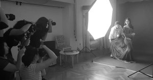 Olga Vuscan New Born Photographer for Workshops by Camen Bergmann Studio setting up lights and a dress