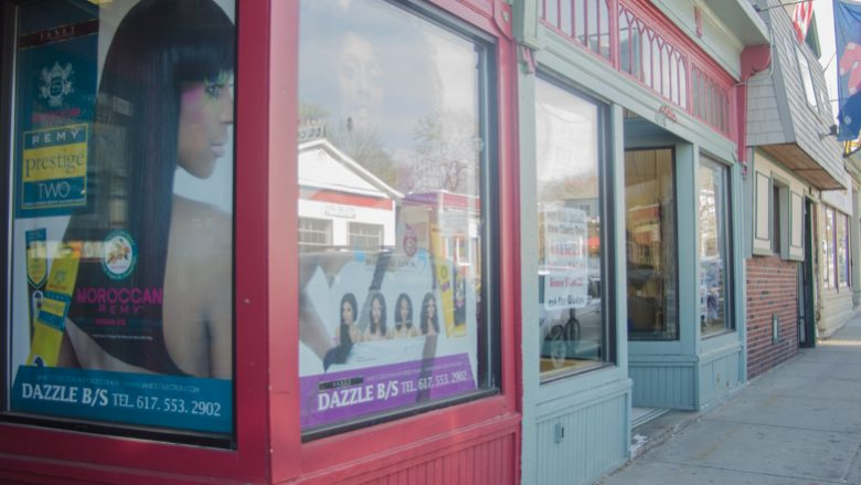 The front of Gladys Freeman's Dazzles Hair Salon stands out on Washington Street in Roslindale. (New Boston Post photo by Kara Bettis)