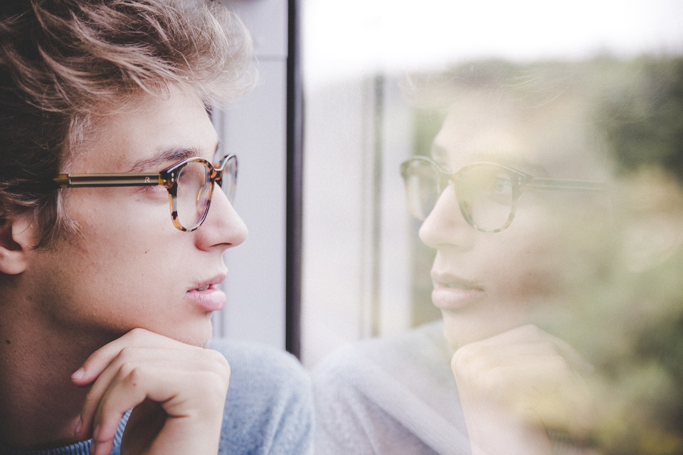 Teenager looking out the window
