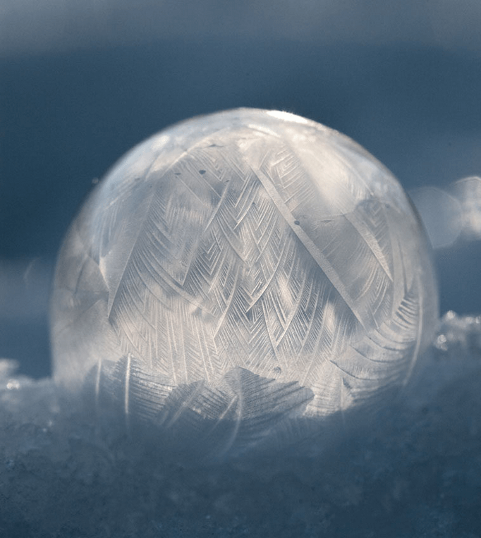 A frozen bubble shines with light.