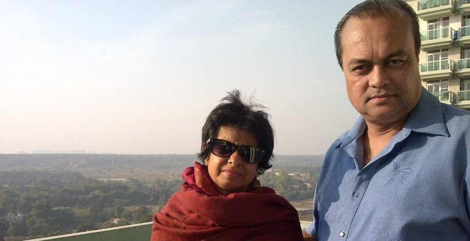 Priti Podder and Joygopal Podder on the roof of a building