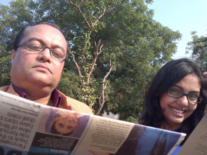 Piya and Joygopal P. reading the newspaper