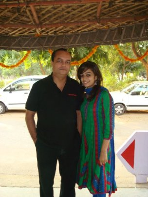 Panvi Podder in a green and blue dress and Joygopal Podder