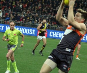 Toby Greene marks in the left pocket at the Western end of the Sydney Showgrounds. Photo: Jodie Newell