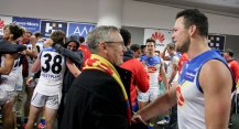 Suns CEO Mrk Evans talks with skipper Stephen May after their historic win over the Swans. Photo: Jodie Newell