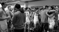 Backslapping aplenty. The Gold Coast players & staff bask in victor. Photo: Jodie Newell