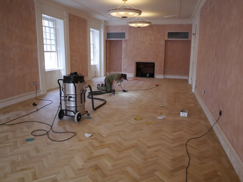 sanding oak floor by hand with head torch
