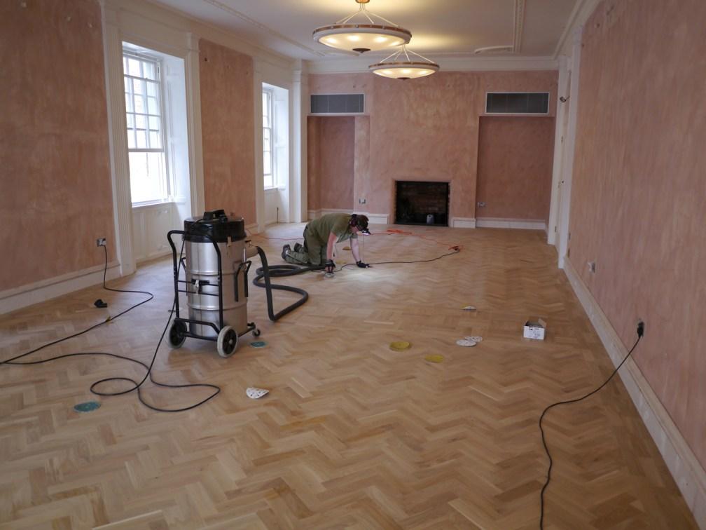 sanding oak floor by hand with head torch