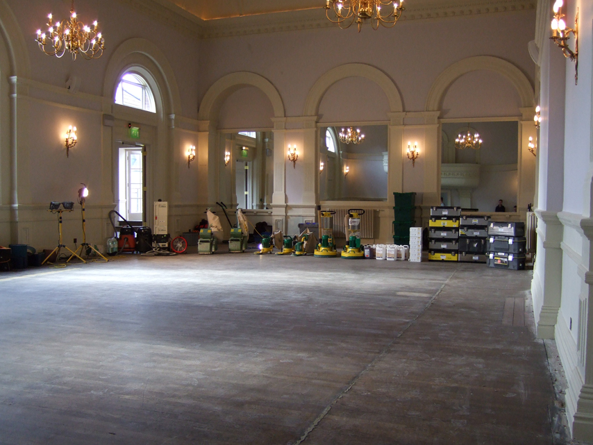 old oak ballroom floor with sanding machines in distance