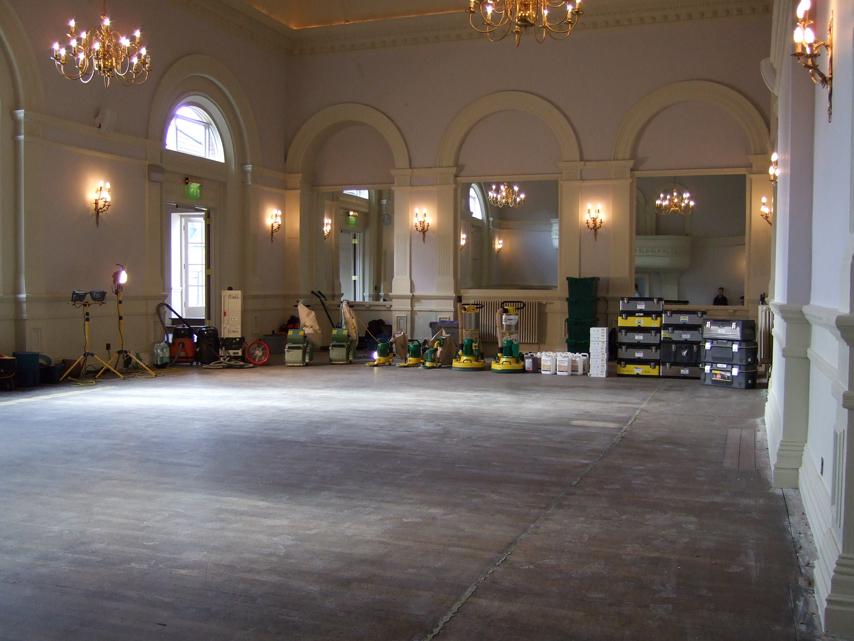 old oak ballroom floor with sanding machines in distance
