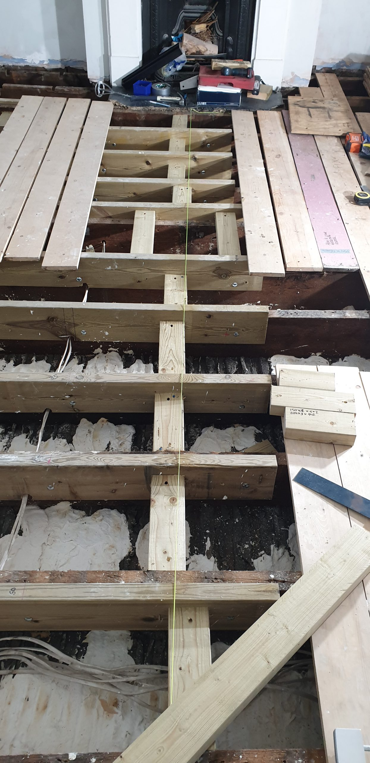 Floor joist levelling to Victorian pine floor in Hackney