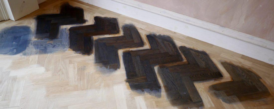 Oak parquet floor staining colour sample in situ