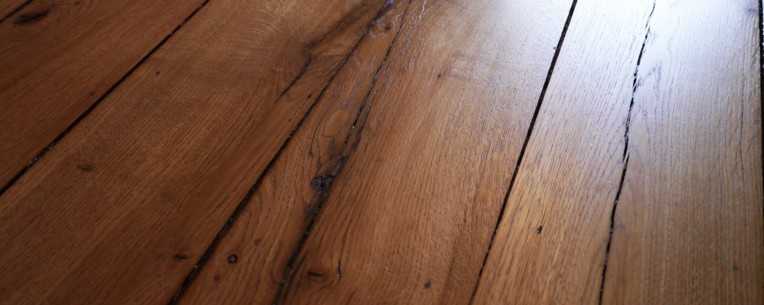 Reclaimed oak floor with light stain tint and matt lacquer