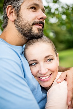 Empty-nester aged couple embracing happily. This image is meant to represent a healthy relationship and emotionally connected couple who have attended a Hold Me Tight Workshop in Massachusetts with New England Hold Me Tight.