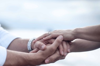 Lesbian couple holding hands. This image is meant to portray the positive connection LBGTQ couples experience after attending an EFT marriage intensive in Maine, an EFT marriage intensive in Connecticut, or an EFT marriage intensive in Massachusetts.