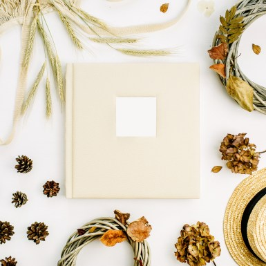 Album with fall items around it. Image is meant to represent a communication exercise done at an emotionally focused couples therapy intensive in Maine, an Emotionally Focused Couples therapy intensive in Connecticut, or an Emotionally Focused couples therapy intensive in Massachusetts.