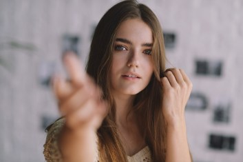 Girl reaching out to camera. This image is meant to portray the pursuer that we see in Emotionally Focused Therapy. Couples can learn more about EFT in Hold Me Tight Couples Retreat.