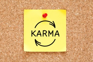Sticky note stating 'karma' with arrow signs on corkboard. This image is meant to portray how we receive what we invest by attending a private marriage retreat in New England or a private marriage retreat in Massachusetts.