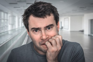 White middle-aged man biting nails in apparent relationship distress due to poor communication. This image is meant to portray how people like him may benefit from attending a Hold Me Tight Couples retreat in Massachusetts, a Hold Me Tight Coupes retreat in Maine, or a Hold Me Tight Couples retreat in Connecticut.