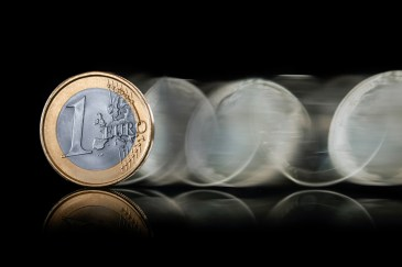 Euro coin flipping across table. This image is meant to portray the two sides of a conflict couples can have. This information can be learned at a Hold Me Tight Retreat in Massachusetts or a Hold Me Tight retreat in New England.