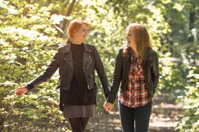 Lesbian couple walking together. This image portrays emotional connection and better communication after attending a lesbian couples counseling retreat in MA.