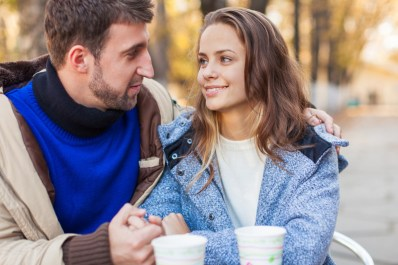 Couple smiling at each other over coffee. This image is meant to portray good communication and emotional connection from attending an EFT couples retreat in Massachusetts.