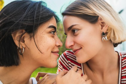 bi-racial lesbian couple looking into each other's eyes. This image is meant to portray the emotional connection a lesbian couple will experience from attending a private relationship retreat or a Hold Me Tight Workshop with New England Hold Me Tight.