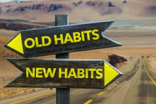 Two arrow signs pointing opposite directions with 'old habits' and 'new habits' on them. This image is meant to portray the change that can happen when a couple attends a couples therapy retreat in Maine or a couples therapy retreat in Connecticut.