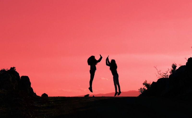 Apparently lesbian couple jumping in silhouette. This signifies feeling good after getting relationship help with a lesbian expert or a lesbian relationship coach and attending a lesbian-friendly hold me tight workshop.